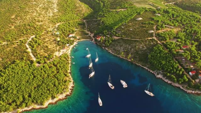 aerial sailboats on the island in croatia - croatia stock videos & royalty-free footage