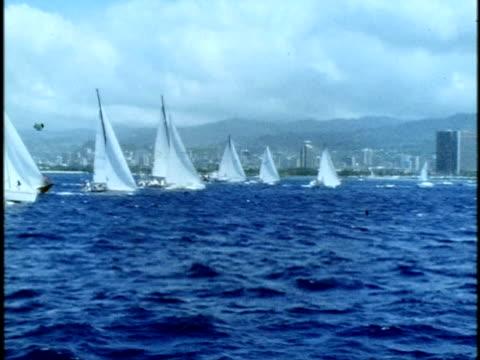 1975 montage ws sailboats racing in regatta off coast of oahu/ oahu, hawaii islands, usa - regatta stock-videos und b-roll-filmmaterial