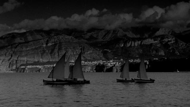 sailboats travel across the ocean near coastal mountains in 1942. - 1942 stock videos & royalty-free footage