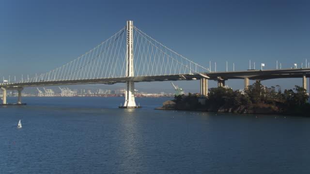 sailboats under the bay bridge - drone shot - oakland california stock videos & royalty-free footage
