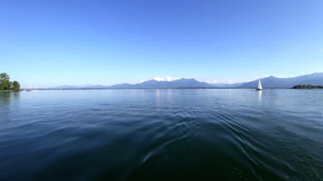 POV: Sailing at lake Chiemsee, Bavaria, in summer
