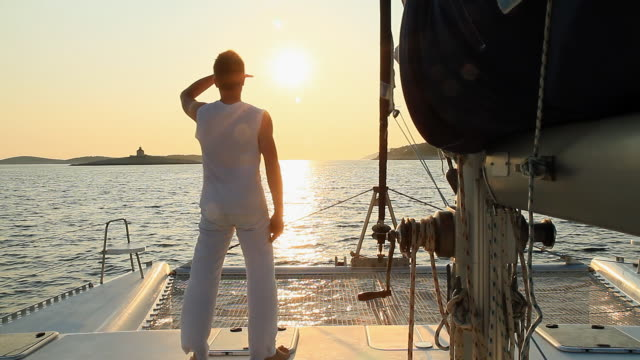 hd: sailing at sunset - standing stock videos & royalty-free footage