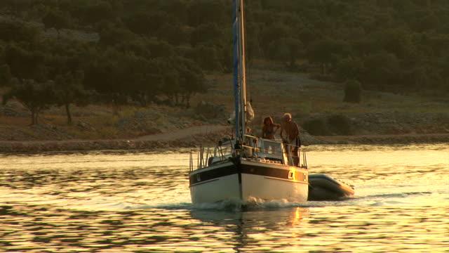 hd: sailing at sunset - shirtless stock videos & royalty-free footage
