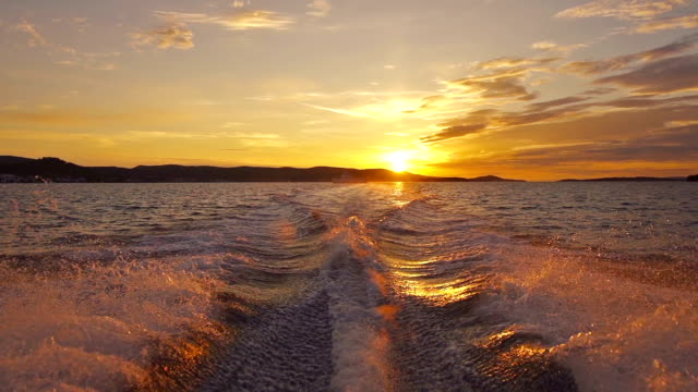 sailing away from sunset - sunset stock videos & royalty-free footage