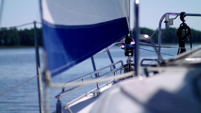 sailing boat details. sun shining through sails, and rigging - rigging stock videos & royalty-free footage