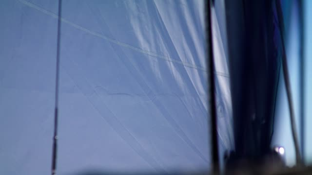 sailing boat details. sun shining through sails - sail stock videos & royalty-free footage