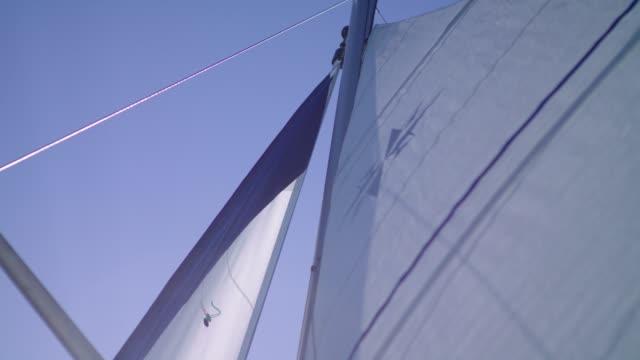 sailing boat details. sun shining through sails - sail stock videos & royalty-free footage