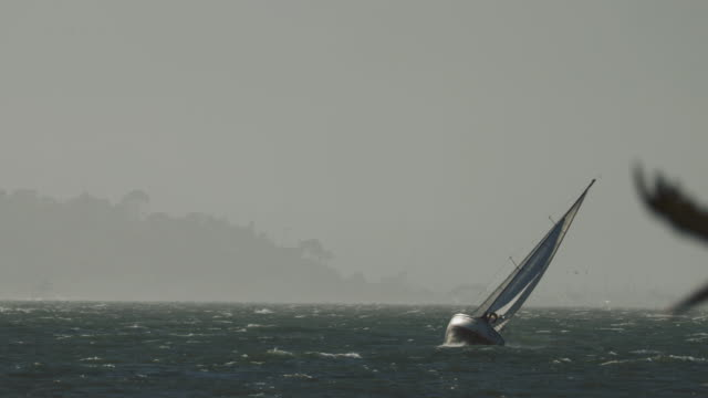 sailing boat in a gale with huge wind - sailing boat stock videos and b-roll footage