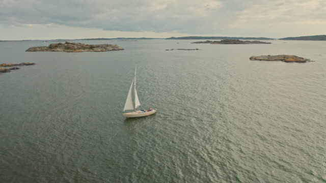 sailing boat in gothenburg archipelago aerial over water - speed boat stock videos & royalty-free footage