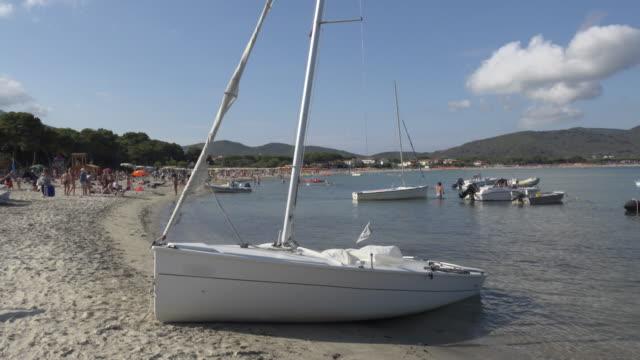 sailing boat on beach at marina di campo - island of elba stock videos & royalty-free footage