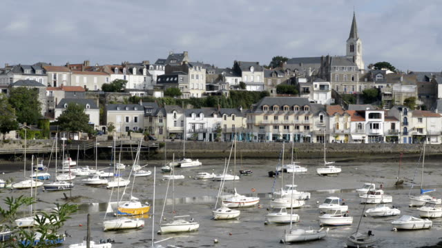 sailing boats in port of pornic at low tide - low tide stock videos & royalty-free footage