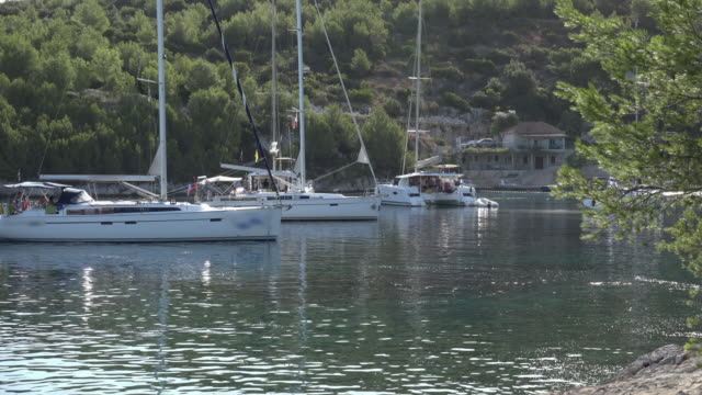 sailing boats moored in a bay - mare adriatico video stock e b–roll