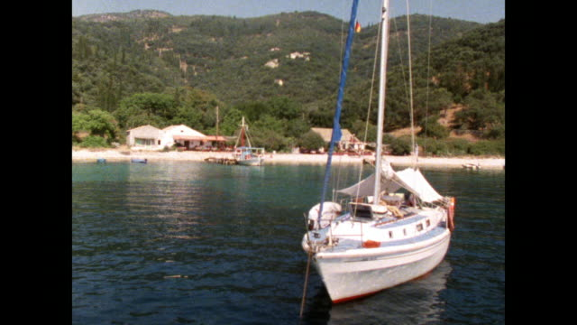 sailing boats moored in peaceful cove; 1986 - bay of water stock videos & royalty-free footage
