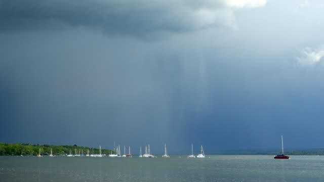 sailing boats on lake with a rising thunderstorm, inning stegen, fuenfseenland, upper bavaria, bavaria, germany - inning stock videos & royalty-free footage