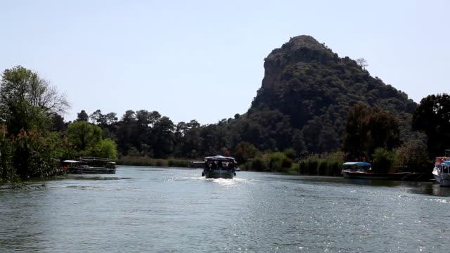 sailing in the dalyan river, dalyan river, turkey - dalyan stock videos and b-roll footage