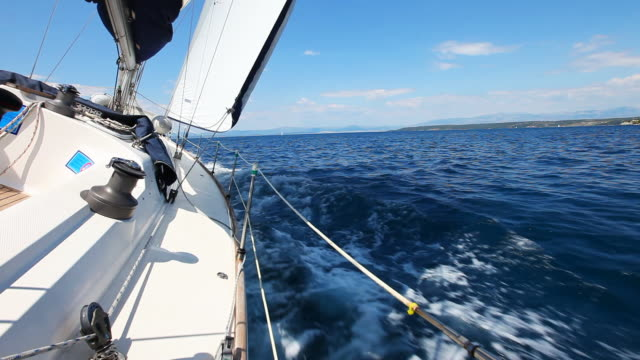 stockvideo's en b-roll-footage met hd: sailing in the wind with sailboat - jachtvaren