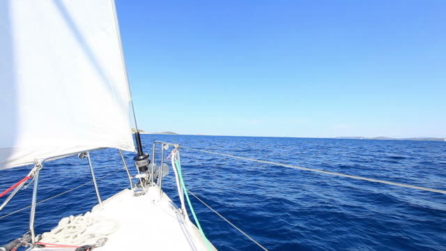 hd: sailing in the wind with sailboat - sailor stock videos & royalty-free footage