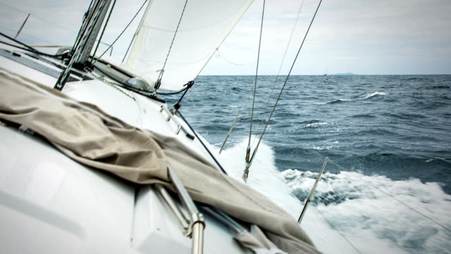hd: sailing in the wind with sailboat - sailing boat stock videos and b-roll footage