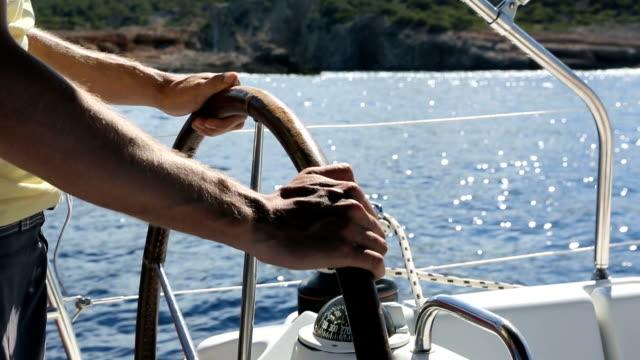 Sailing - Man at rudder