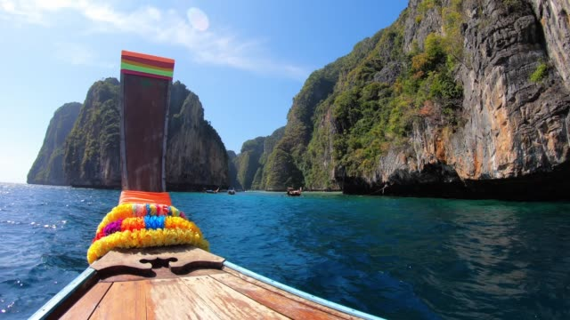 sailing on a longtail boat in thailand, phi phi island - phi phi islands stock videos & royalty-free footage