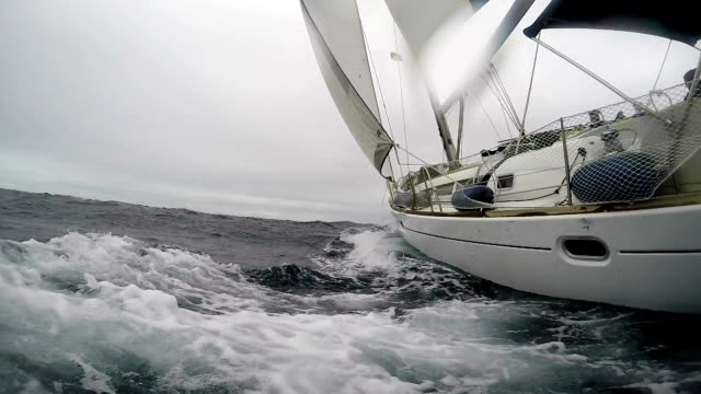 stockvideo's en b-roll-footage met zeilen op een ruwe zee - nautical vessel
