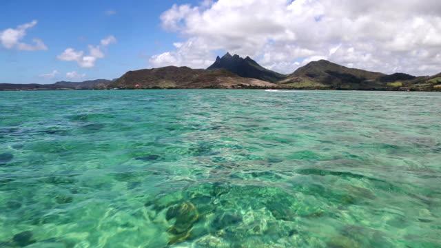 Sailing on lagoon off Mauritius island in the Indian ocean.