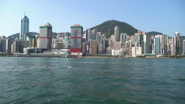 sailing on victoria harbor in hong kong - hong kong island stock videos & royalty-free footage
