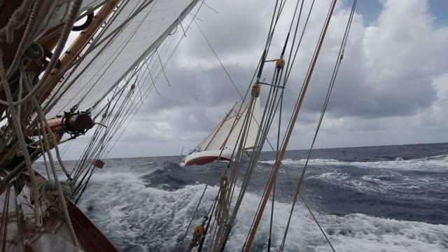 "sailing onboard classic yacht ""adventuress"", antigua classic yacht regatta, british west indies - british rail stock videos & royalty-free footage"