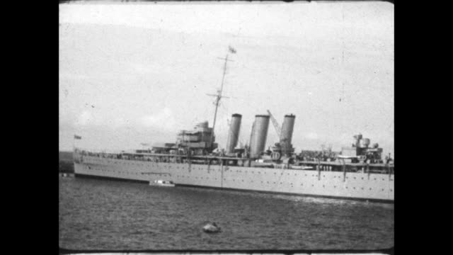sailing past royal navy heavy cruiser moored in the bay. - ghana stock videos & royalty-free footage
