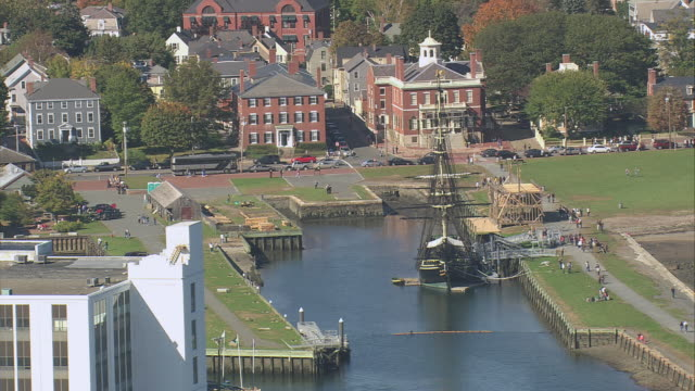 aerial sailing ship friendship of salem docked, darby house and customs house beyond / salem, massachusetts, united states - salem massachusetts stock videos & royalty-free footage