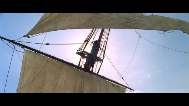 slo mo sailing ship's mast, with one sail untied and fluttering in the breeze - untied stock videos and b-roll footage