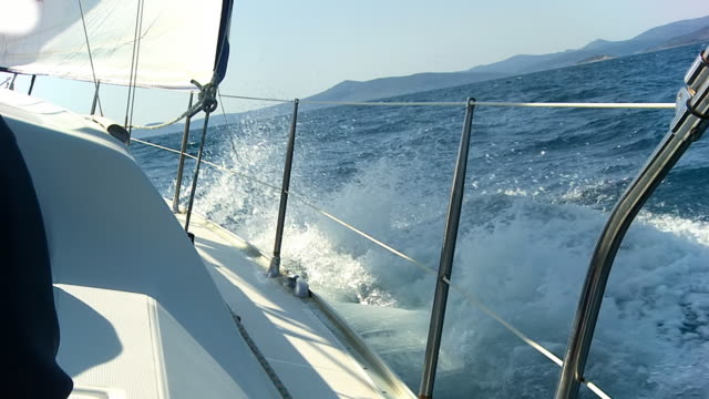 hd slow motion: sailing through sea waves - ship's bow stock videos and b-roll footage
