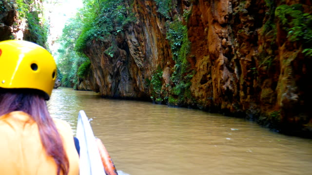 sailing through the canyon, jioxiang cave, china - speleology stock videos and b-roll footage
