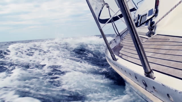 hd: sailing through the waves - sailing boat stock videos and b-roll footage