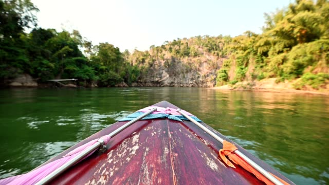 sailing wooden long-tail boat with sightseeing tropical forest in river kwai - dinghy stock videos & royalty-free footage