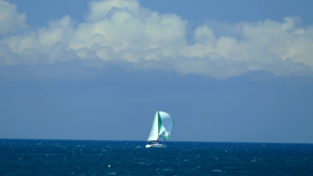 sailing yacht against a cloudy sky - yacht stock videos & royalty-free footage