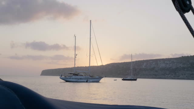 sailing yacht anchored during sunrise - anchored stock videos & royalty-free footage