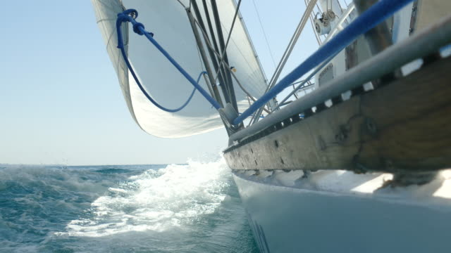 sailing yacht rushes at full sail - rigging nautical stock videos & royalty-free footage