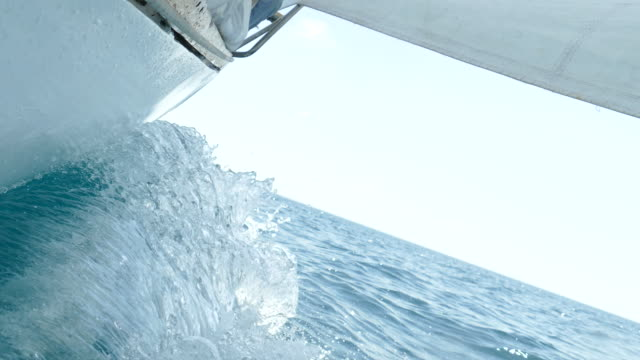 sailing yacht rushes on waves
