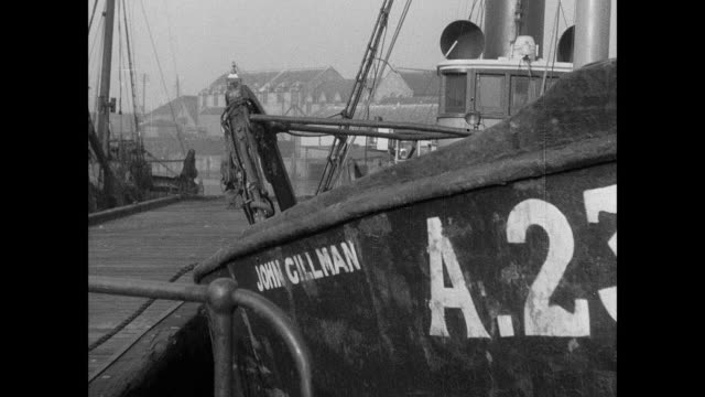 montage a sailor boards a fishing trawler in port / aberdeen, scotland, united kingdom - aberdeen schottland stock-videos und b-roll-filmmaterial