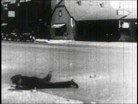 B/W 1927 sailor (Bill Blaisdell) driving car in reverse into traffic cop on street / feature