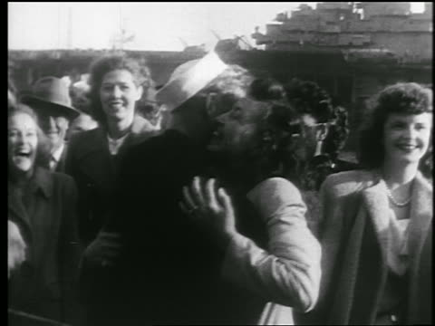 b/w 1945 sailor hugs 2 women / end of wwii / educational - 30 39 years stock videos & royalty-free footage