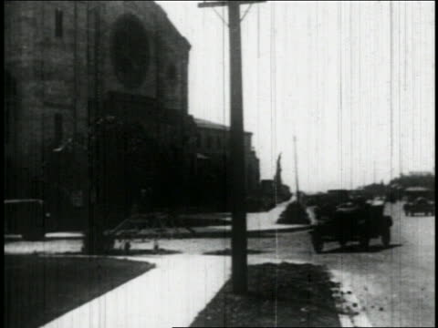 B/W 1927 sailor (Bill Blaisdell) in car crashing into telephone pole + knocking it down / feature