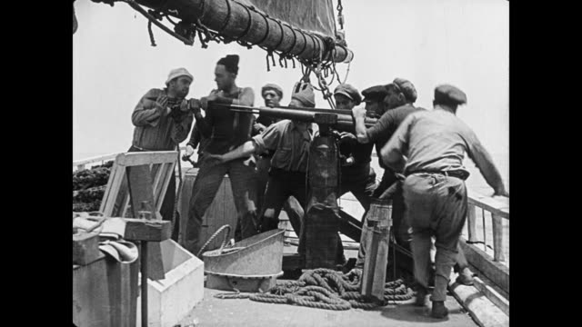 1923 sailor in crow's nest spots whale and crew prepare ship's harpoon for firing - arpone video stock e b–roll