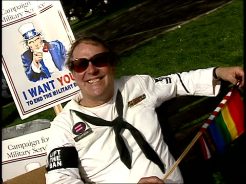 sailor in uniform wearing 'lift the ban' armband for gay rights in washington dc - sailor suit stock videos and b-roll footage