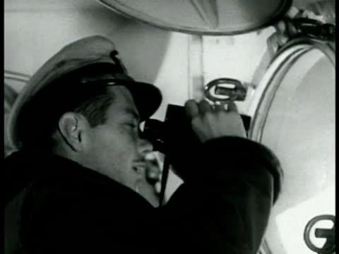sailor looking through sextant. officer using binoculars. radioman in headset w/ mouthpiece. sailors on deck of battleship near guns. sailor using... - binoculars stock videos & royalty-free footage