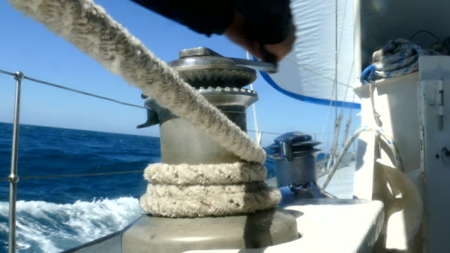sailor manages a sail on the winch - mast stock videos & royalty-free footage
