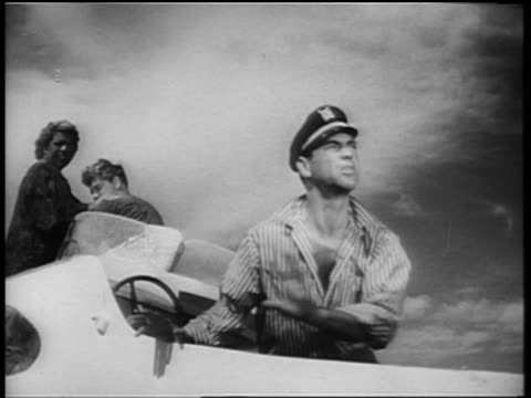 b/w 1961 sailor (anthony carbone?) on boat stepping back in horror from something offscreen - b rolle stock-videos und b-roll-filmmaterial