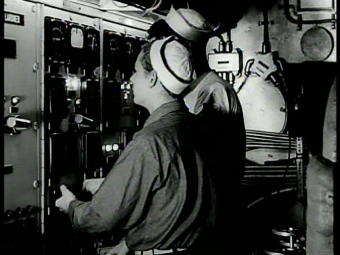 sailor on bridge steering ship wheel ms sailors in engine room la ms officer sailor talking ms men in cramped engine room ms watching dial ext ha ws... - 1942 stock videos and b-roll footage