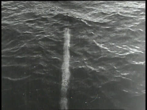 vidéos et rushes de sailor on ship / torpedo streaking below surface of water / black man looking over rail - marin